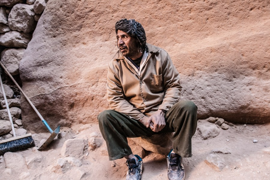 A Petra Bedouin works in the historical site as janitor. He watches visitors walk by.