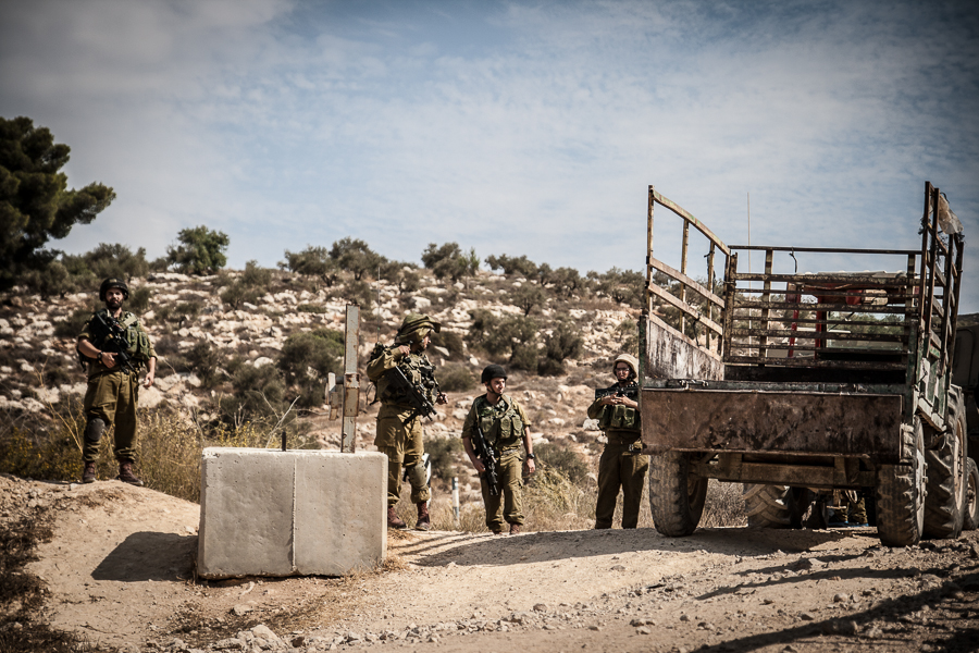 IDF soldiers block the way for Palstinian Olive farmers in the West Bank, October 2012 (5)