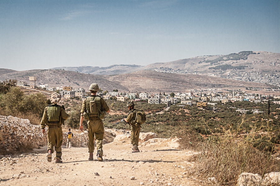 IDF soldiers block the way for Palstinian Olive farmers near the village of Salem in the West Bank, October 2012 (1) (1)