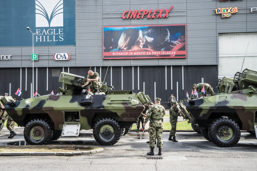 Serbian Soldiers clean their tanks in front of a Shopping Center in Belgrade o 16. October 2014