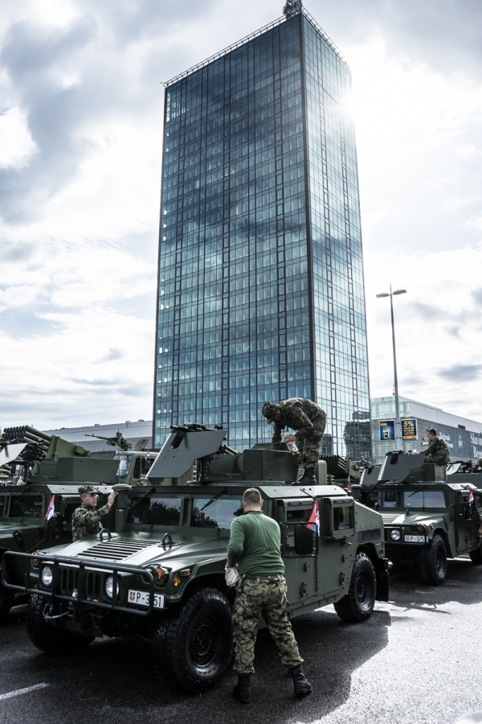Serbian Soldiers clean their tanks in front of Hypo Alpe Adria tower in Belgrade o 16. October 2014